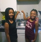 Twins conduct a science experiment using water.